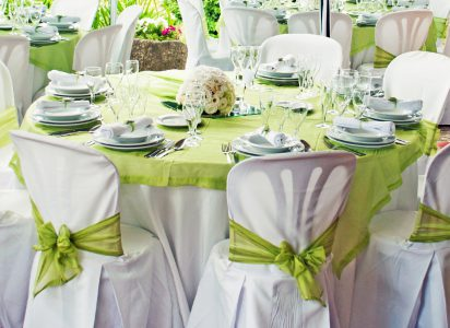 gorgeous wedding chairs and table setting for fine dining at outdoors
